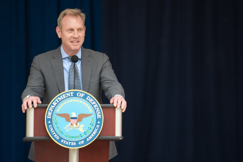 Deputy Defense Secretary Patrick M. Shanahan speaks from a podium.