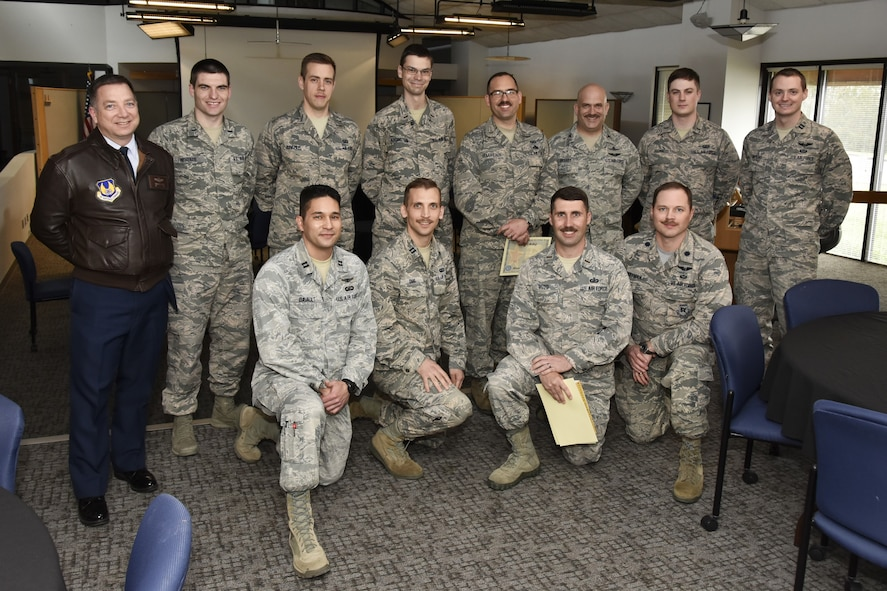 """Arnold Air Force Base Company Grade Officers Council display their mustaches in honor of Mustache March at the Gossick Leadership Center March 30, 2018. Mustache certificates were awarded to 1st Lt. Benjamin Sinemus – The """"Barely There"""" award (back row, third from left), 2nd Lt. Ryan Boudreaux – 36-2903 SME award (back row, fifth from left), Col. Michael Brandt – 36-290…Never Heard of Her award (back row, sixth from left), Capt. Jonathan Dias – The """"Free Candy"""" award (front row, second from left) and 2nd Lt. Charles Boyd – """"Room 'Tench Hut"""" award (front row, third from left). Also pictured, back row: Col. Timothy West, 1st Lt. John McKenzie, Sinemus, 2nd Lt. Nicholas Addington Ramosechandi, Boudreaux, Brandt, 1st Lt. Thomas Julian, Capt. Adam Hopkins; front row: Capt. Michael Davault, Dias, Boyd and Lt. Col. David Hoffman. (U.S. Air Force photo/Rick Goodfriend)"""