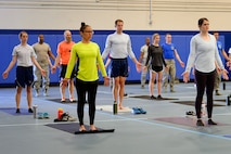 Schriever Air Force Base, Colorado members participate in Resilience Yoga, led by Laurie Works, during wingman Day May 4, 2018. Yoga was one of 28 base-wide events created to further build resilience skills so that Airmen can better handle stress, and bounce back from adversity. (U.S. Air Force photo by Kathryn Calvert)