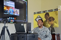 Staff Sgt. Jordan Peterson, a web developer for the 709th Cyberspace Squadron, Air Force Technical Applications Center, Patrick AFB, Fla., Skypes with Daniell Middle School student Collin Fairey April 25, 2018.  Peterson discussed his military service with Fairey and his fellow Advance Reading classmates about life in the military and the importance of a STEM education.  (U.S. Air Force photo by Susan A. Romano)