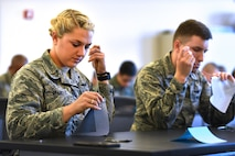 Second Lt. Kristina Brandes, 50th Operations Support Squadron, practices her newly learned sewing techniques in a sewing class during Schriever's biannual wingman day at Schriever Air Force Base, Colorado May 4, 2018.  Wingman Day is a multi-session event structured for members of the 50th Space Wing to enhance their resilience and sense of community.  (U.S. Air Force Photo by Dennis Rogers)