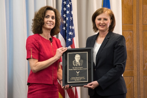 Lynda Rutledge (left), the Mobility and Training Aircraft Directorate Program Executive Officer, presented the 2017 Dr. James G. Roche Sustainment Excellence Award to Angela Micheal, T-38 Program Manager, May 8, 2018, at Hill Air Force Base, Utah. Micheal accepted the award on behalf of the Air Force Life Cycle Management Center T-38 Program Office. (U.S. Air Force photo)
