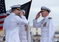 Cmdr. Heath E. Johnmeyer, right, relieves Cmdr. Eric J. Rozek during the Virginia-class fast-attack submarine USS Mississippi (SSN 782) change of command ceremony on the submarine piers in Joint Base Pearl Harbor-Hickam, May 8. (U.S. Navy photo by Mass Communication Specialist 2nd Class Michael Lee/Released)