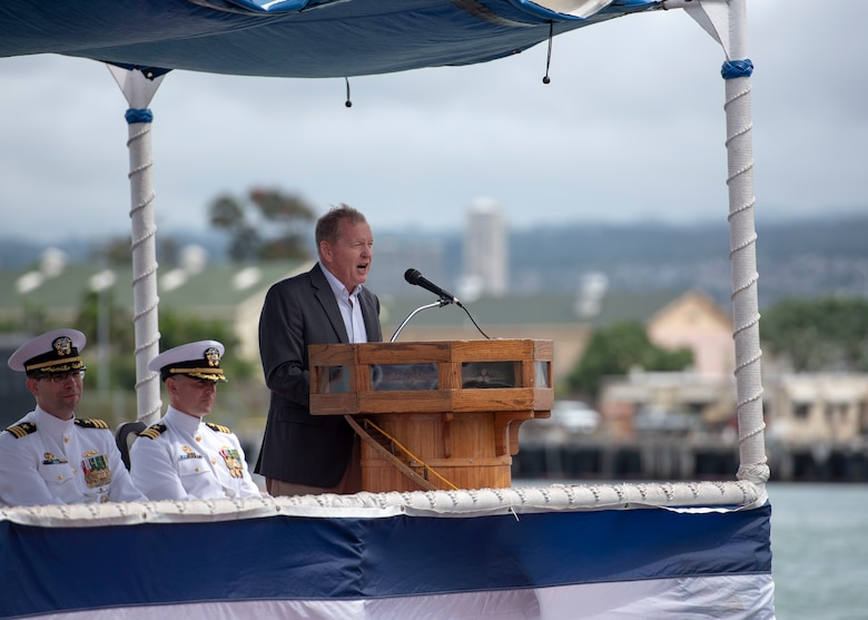 180508-N-LY160-0080 PEARL HARBOR (May 8, 2018) - Rear Adm. (ret.) Barry L. Bruner addresses guests during the Virginia-class fast-attack submarine USS Mississippi (SSN 782) change of command ceremony on the submarine piers in Joint Base Pearl Harbor-Hickam, May 8. Cmdr. Heath E. Johnmeyer relieved Cmdr. Eric J. Rozek as Mississippi's commanding officer. (U.S. Navy photo by Mass Communication Specialist 2nd Class Michael Lee/Released)
