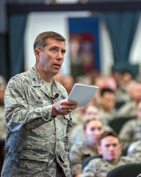 U.S. Air Force Col. John Klein, 60th Air Mobility Wing commander, addresses members of the 60th AMW during a commander's call at Travis Air Force Base, Calif., May 8, 2018. Klein is conducting his last commander's calls as the commander of the 60th AMW before departing in July. (U.S. Air Force photo by Louis Briscese)