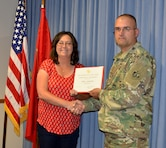 ALBUQUERQUE, N.M. -- The District's Deputy Commander Maj. John Miller presents Jamie Crawford with a certificate of achievement, May 7, 2018, for being selected as the District's Administrative Professional of the Year.