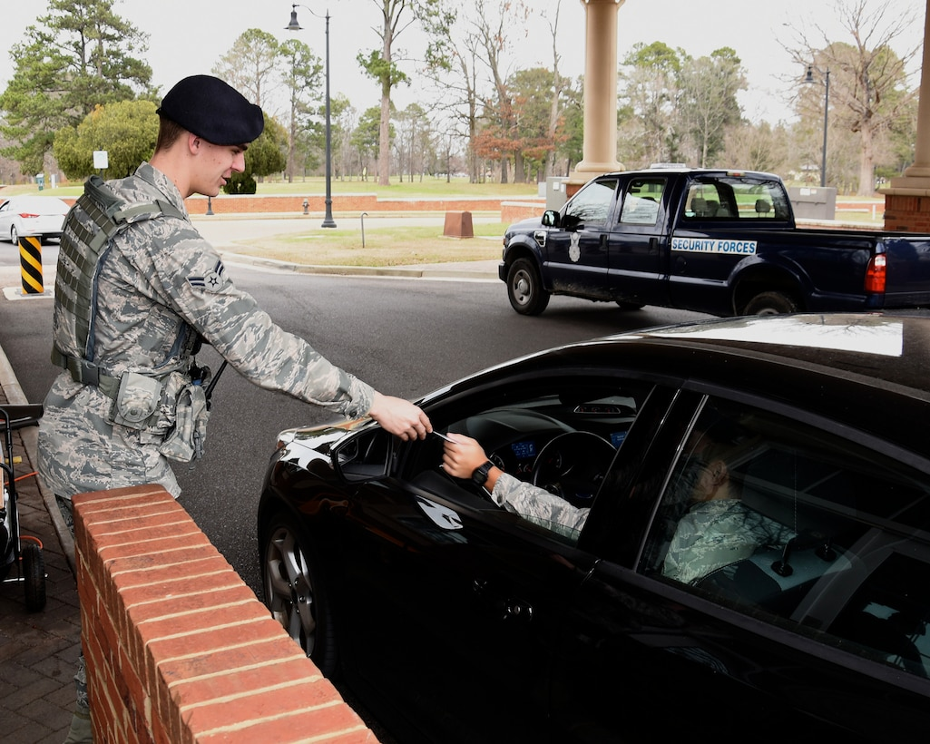 Airman 1st Class Jacob Lightsey, 14th Security Forces Squadron patrolman, checks a military ID Feb. 16, 2017, on Columbus Air Force Base, Mississippi. Security Forces defenders are the front line for protecting Airmen, their families and Air Force resources from harm. (U.S. Air Force photo by Elizabeth Owens)