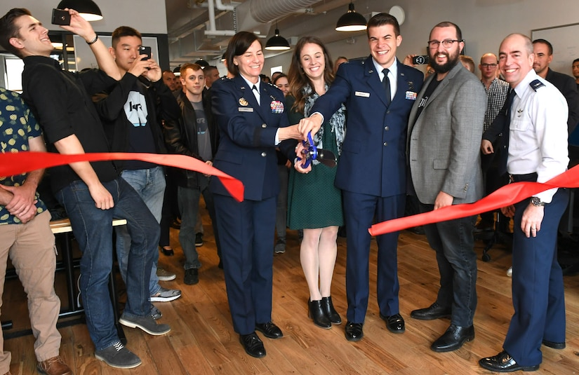 Maj. Gen. Sarah Zabel, the Air Force's director of Information Technology Acquisition Process Development at the Pentagon, cuts the ribbon for the Kessel Run Experimentation Lab opening in Boston May 7