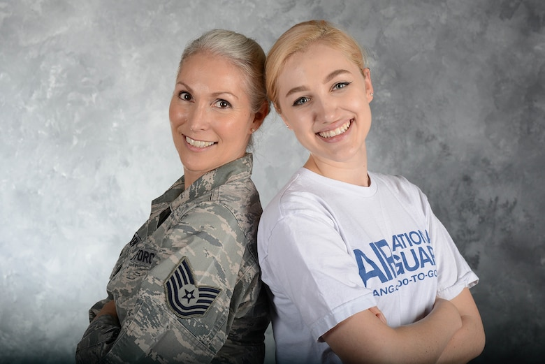 Tech. Sgt. Lisa Menken, a contract specialist with the 136th Mission Support Group, Texas Air National Guard, poses with her daughter Charrisa Menken April 29, 2018 in the 136th Airlift Wing Public Affairs studio at Naval Air Station Fort Worth Joint Reserve Base, Texas.