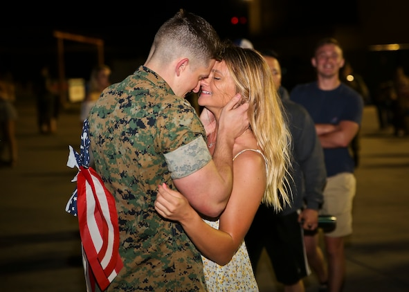 A Marine is welcomed home by a loved one after returning from a deployment May 7. Marines and Sailors of Marine