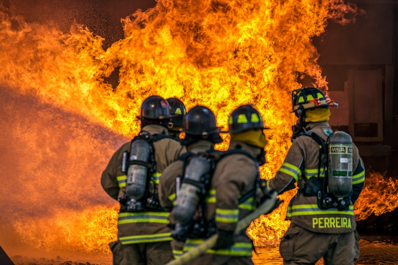 Firefighters assigned to the 23rd Civil Engineer Squadron extinguish an aircraft fire during live-fire training, April 24, 2018, at Moody Air Force Base, Ga. Firefighters from the 23rd CES and Valdosta Fire Department participated in the training to gain more experience fighting aircraft fires and to work together as a cohesive team while still practicing proper and safe firefighting techniques. (U.S. Air Force photo by Airman 1st Class Eugene Oliver)