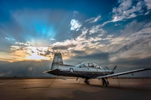 A T-6A Texan II is used to train specialized undergraduate pilots at Vance Air Force Base, Okla., April 24, 2018. The Texan has a thrust-to-weight ratio that allows the aircraft to perform an initial climb of 3,100 feet per minute and reach a height of 18,000 feet in less than six minutes. (U.S. Air Force photo by Erik Cardenas)