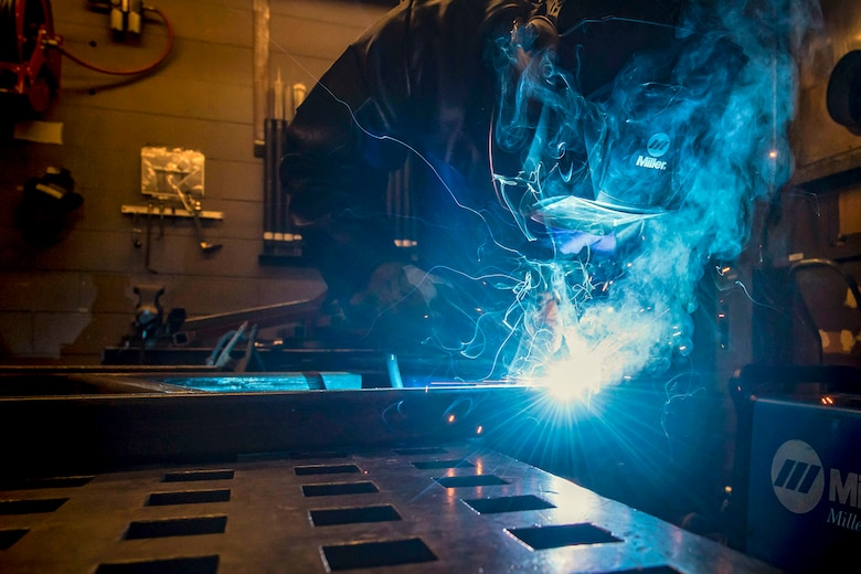 Airman 1st Class Isaiah Jackson, 23rd Maintenance Squadron aircraft metals technology journeyman, welds components of a table, April 25, 2018, at Moody Air Force Base, Ga. Metals technicians support the mission by utilizing fabrication techniques to repair and overhaul countless tools and aircraft parts. The technicians strive to exercise safe and precise fabrication techniques to be able to sufficiently handle their intense workload. (U.S. Air Force photo by Airman 1st Class Eugene Oliver)