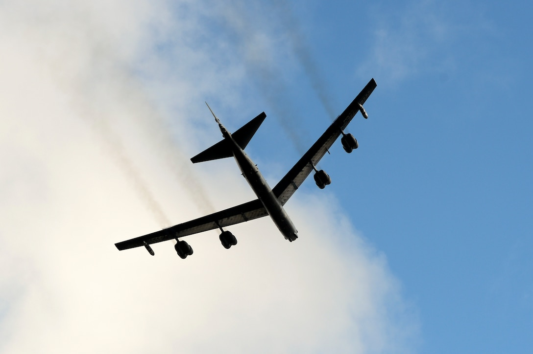 A U.S. Air Force B-52 Bomber makes a fly-by over a monument dedication ceremony for Lt. Gen. Frank Maxwell Andrews and his 13 crew members, May 3, 2018, in Keflavic, Iceland. The ceremony recognized the 75th anniversary of the crash of the B-24 Liberator, 'Hot Stuff' which resulted in the death of Andrews and his crew. (U.S. Air Force photo by Staff Sgt. Kenny Holston)