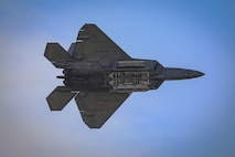 An F-22 Raptor piloted by Maj. Paul Lopez performs a single-ship demonstration at the 2018 Power in the Pines Open House and Air Show rehearsal held at Joint Base McGuire-Dix-Lakehurst, N.J., May 4, 2018. The F-22 Demo Team is based out of Joint Base Langley-Eustis, Va. (U.S. Air National Guard photo by Master Sgt. Matt Hecht)