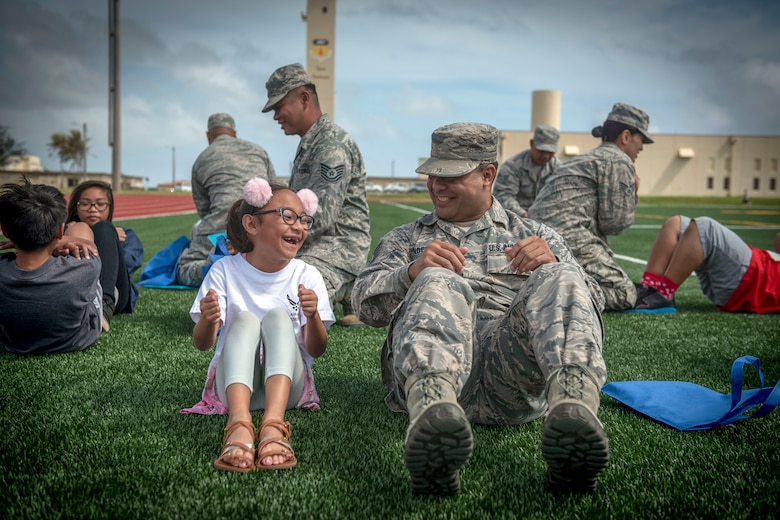 "Air Force reservists assigned to the 44th Aerial Port Squadron, introduce military children to deployment processing procedures during Operation Inafa' Maolek at Andersen Air Force Base, Guam, May 5, 2018. Military families shared a playful version of military processing to introduce children of deploying reservists to what their parents will experience when preparing for their deployment. The Chamorro term ""Inafa' Maolek"" literally translates into 'to make' (inafa') 'good' (maolek). It describes the concept of restoring harmony or order. (U.S. Air Force photo by Staff Sgt. Alexander W. Riedel)"