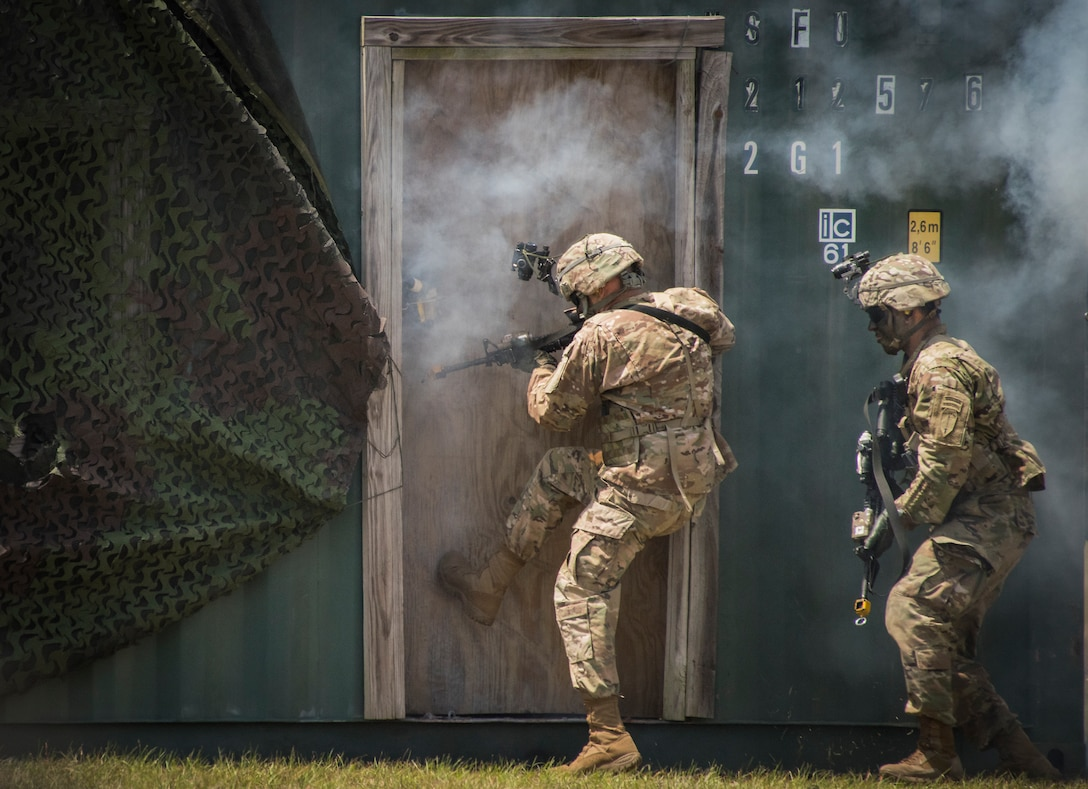 An Army Ranger kicks in a door during a demonstration at the 6th Ranger Training Battalion's open house event May 5, 2018, at Eglin Air Force Base, Fla. The event was a chance for the public to learn how Rangers train and operate. The event displays showed equipment, weapons, a reptile zoo, face painting and weapon firing among others. The demonstrations showed off hand-to-hand combat, a parachute jump, snake show and Rangers in action. (U.S. Air Force photo by Samuel King Jr.)