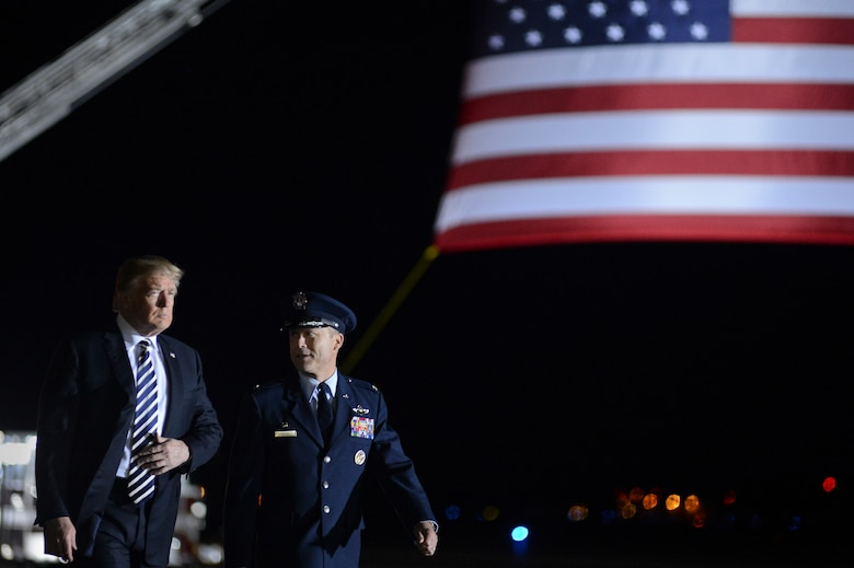 President of the United States Donald J. Trump walks with Col. Casey D. Eaton, 89th Airlift Wing commander at Joint Base Andrews, Md., May 10, 2018, as they prepare to greet three Americans who were freed from North Korea on May 9. An 89th AW C-40 high-priority personnel transport aircraft carried Kim Dong-chul, Tony Kim and Kim Hak-song from North Korea to Anchorage, Alaska, where the plane refueled before arriving at JB Andrews. The 89th AW executes special missions such as these on a routine basis while enabling national interests through global transportation for America's senior leaders. (U.S. Air Force photo by Staff Sgt. Kenny Holston)