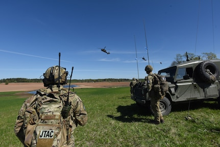 U.S. Air Force Tech Sgt. Laurence Paradis, Tactical Air Control Party member with Oklahoma National Guard's 146th Air Support Operations Squadron, advises Estonian Defense Force on Joint Terminal Attack Controller capabilities May 9, 2018, during Exercise HEDGEHOG 2018 in Southern Estonia. The TACP personnel served as advisers to the Estonian Defense Force to create combined fires between U.S. Army and multinational aviation assets.