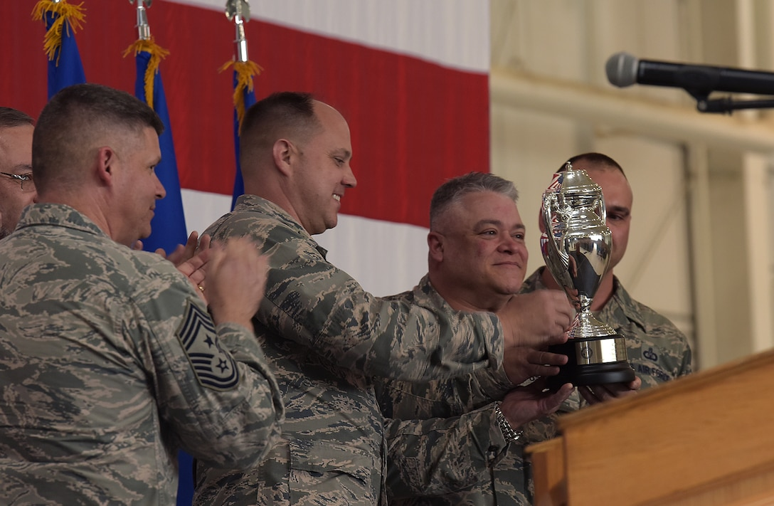 The 509th Bomb Wing and 131st Bomb Wing commanders hold up the Omaha Trophy during the award ceremony at Whiteman Air Force Base, Mo., May 8, 2018. The Omaha Trophy is awarded to units for excellence in strategic deterrence and global strike. Team Whiteman won the trophy for executing the best Strategic Bomber Operations of 2017.  (U.S. Air Force photos by Airman 1st Class Taylor Phifer)