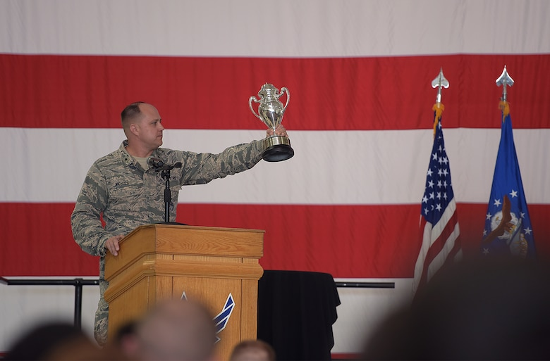 U.S. Air Force Brig. Gen. John Nichols, commander of the 509th Bomb Wing, holds up the Omaha Trophy during the award ceremony at Whiteman Air Force Base, Mo., May 8, 2018. The 509th and 131st Bomb Wings also earned the trophy in 2013 and the 509th received it in 2006. (U.S. Air Force photos by Airman 1st Class Taylor Phifer)