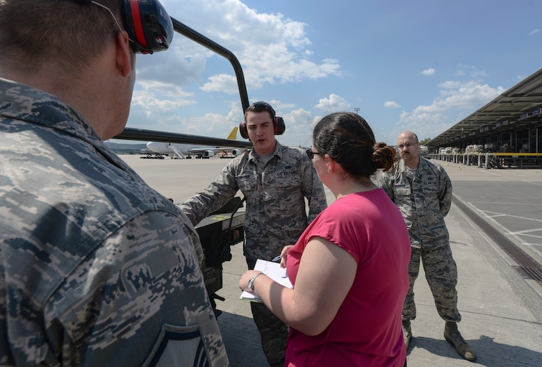 U.S. Air Force Airman 1st Class Kyle Renner, 721st Ariel Port Squadron ramp services specialist, briefs a National Institute for Occupational Safety and Health official during a demonstration May 9, 2018, on Ramstein Air Base, Germany. The bi-annual demonstrations aim to reemphasize the importance of fall protection for service members. (U.S. Air Force photo by Airman 1st Class D. Blake Browning)