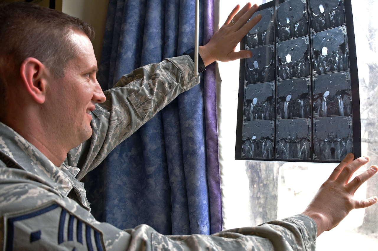 Air Force Master Sgt. Geoffrey VanDyck, the 707th Force Support Squadron's first sergeant, views an image of the tumor found on his auditory nerve, at Fort Meade, Md.