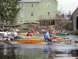 Rat Race participants paddle down the Miller River.  Tully Lake and Birch Hill Dam performed water releases for the popular local race.  200 paddlers participated and 500 spectators watched the event.