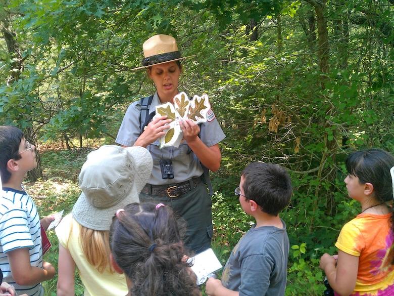 Cape Cod Canal Park Ranger Elisa Carey hosts a leaf presentation for the Junior Ranger Program.