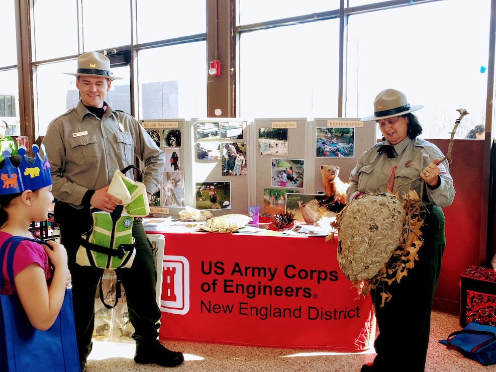 West Hill Dam Park Rangers Ron Woodall and Viola Bramel speak to a student during a local fair.  West Hill Dam Junior Rangers who visit Corps Educational Booths or attend interpretative programs at the dam receive credit towards graduation.