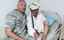 Army doctor with a foreign patient