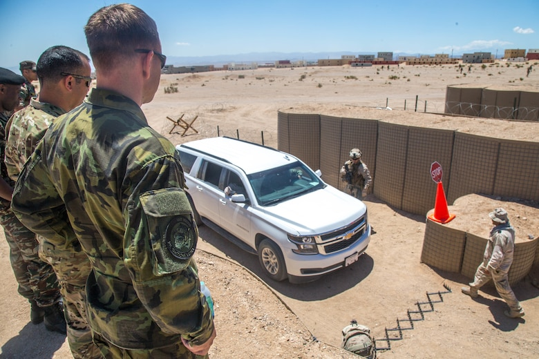 A Czech Air Force officer observes an entry checkpoint control exercise at Range 220 aboard the Marine Corps Air Ground Combat Center, Twentynine Palms, Calif., May 2, 2018. The international officers are students at the Command and Staff College, Marine Corps University, Marine Corps Base Quantico, Va., and are set to graduate June 6, 2018. (U.S. Marine Corps photo by Lance Cpl. Preston L. Morris)