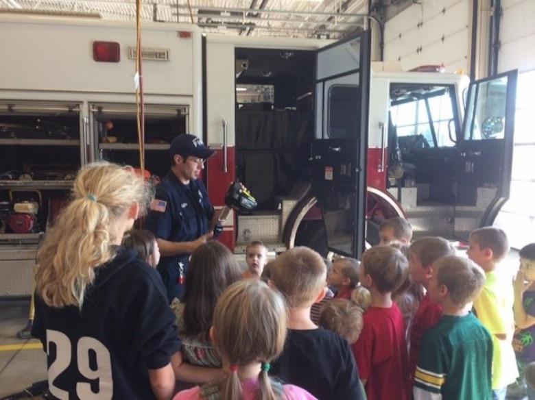 Homeschoolers visit base fire department.