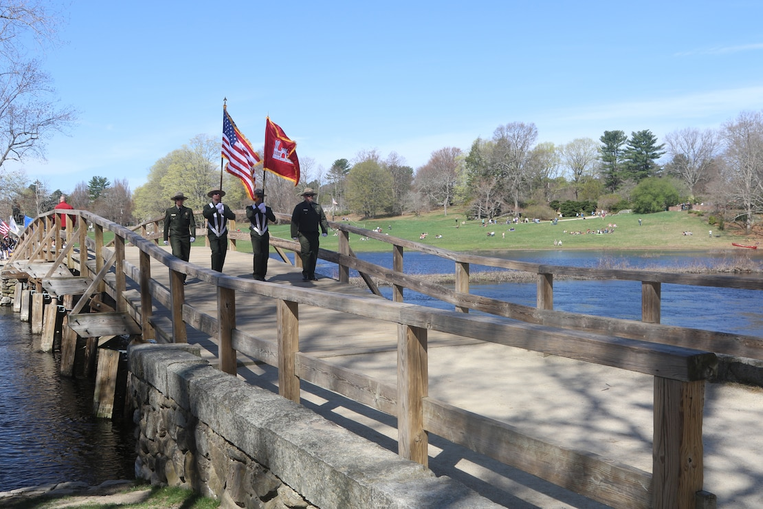 The New England District Ranger Color Guard pass over the Old North Bridge in Concord, Massachusetts during the town's Patriot's Day  parade, April 17, 2017.