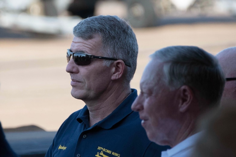 U.S. Air Force Col. Robert VanHoy, 307th Bomb Wing commander, (left) and retired Brig. Gen. Jack Ihle listen to a speech from General Robin Rand, commander of Air Force Global Strike Command, at Barksdale Air Force Base, Lousiana, May 10, 2018.  The two were on hand for a civic leader social.  Civic Leaders from across the Shreveport and Bossier City, Louisiana area gathered to learn more about Barksdale and its mission.  The event featured static displays of the B-52 Stratofortress, B-1 Lancer, and B-2 Spirit aircraft. (U.S. Air Force photo by Master Sgt. Ted Daigle)