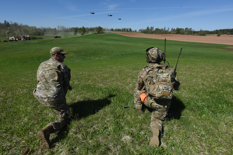U.S. Air Force Maj. Karl Hurdle, Air Liaison Officer (Left), and Tech Sgt. Laurence Paradis, Tactical Air Control Party member with Okla. National Guard's 146th Air Support Operations Squadron, advises Estonian Defense Force on Joint Terminal Attack Controller capabilities May 9th during Exercise HEDGEHOG 2018 in Southern Estonia. The TACP personnel served as advisers to the Estonian Defense Force to create combined fires between U.S. Army and multinational aviation assets.  Photo By Maj. Kurt M. Rauschenberg, 58th EMIB Public Affairs Officer.