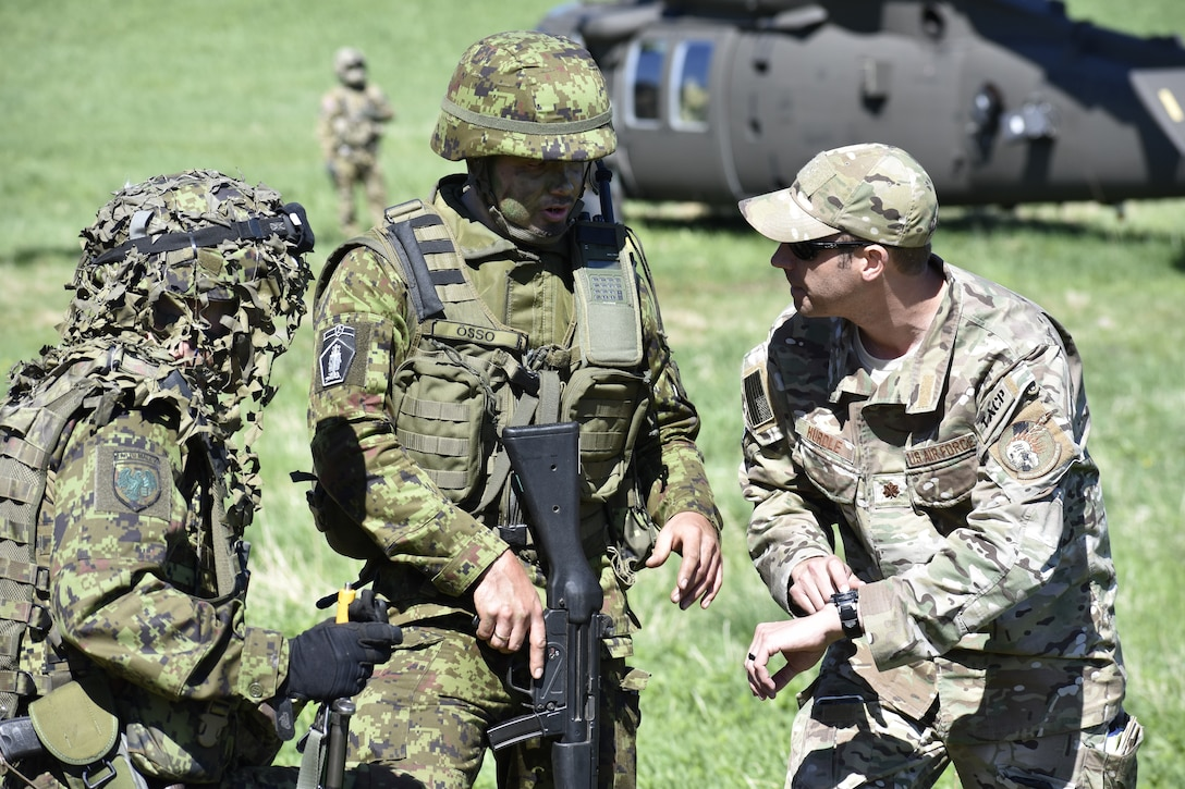 U.S. Air Force Maj. Karl Hurdle, Air Liaison Officer with Okla. National Guard's 146th Air Support Operations Squadron, advises Lt. Janno Õsso, Estonian Defense Force's 2nd brigade ALO, on Joint Terminal Attack Controller capabilities May 9th during Exercise HEDGEHOG 2018 in Southern Estonia. The Tactical Air Control Party members served as advisers to the Estonian Defense Force to create combined fires between U.S. Army and multinational aviation assets.  Photo By Maj. Kurt M. Rauschenberg, 58th EMIB Public Affairs Officer.