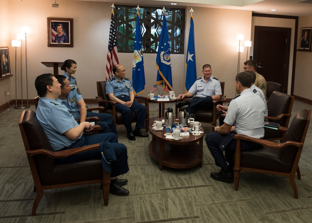 Brig. Gen. Michael Winkler, Pacific Air Forces (PACAF) Strategy, Plans and Programs director talks with Chinese Maj. Gen. Lan, Deputy Political Commissary/Secretary of Discipline Inspection, People's Liberation Army Air Force (PLAAF) Command College during an office call at Joint Base Pearl Harbor-Hickam, April 26, 2018.