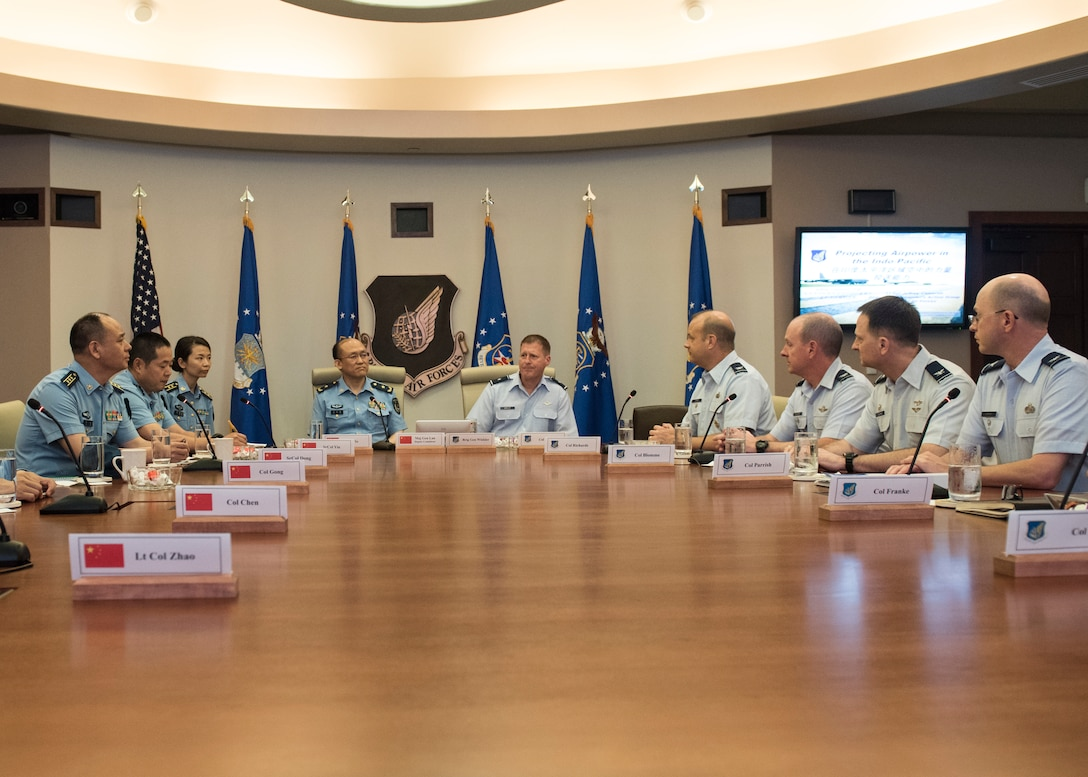 Brig. Gen. Michael Winkler, Pacific Air Forces (PACAF) Strategy, Plans and Programs director and Chinese Maj. Gen. Lan, Deputy Political Commissary/Secretary of Discipline Inspection, People's Liberation Army Air Force (PLAAF) Command College attend a PACAF mission brief at Joint Base Pearl Harbor-Hickam, April 26, 2018.