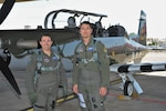 Capt. Kais Heimburger, 455th FTS instructor pilot and Lt. Col. Nik Stathopoulos, 455th FTS director of operations pose next to a T-6 Texan ll aircraft with WWII-era B-26 Marauder paint scheme, May 8, 2018 at Joint Base San Antonio-Randolph. The aircraft is assigned to the 455th Flying Training Squadron. (U.S. Air Force photo by Joel Martinez)