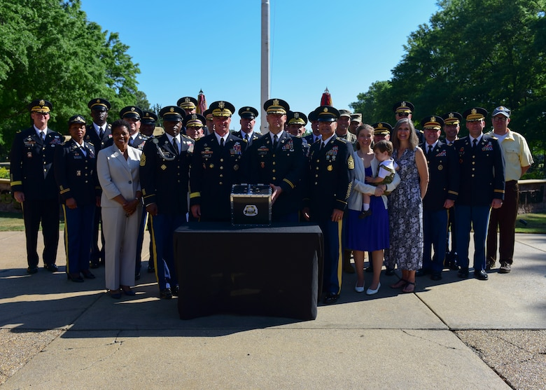 Joint Base Langley-Eustis senior leaders gather around a time capsule at Fort Eustis, Virginia, May 11, 2018. In honor of Fort Eustis' centennial, JBLE also prepared a time capsule containing memorabilia from its various units and organizations. (U.S. Air Force photo by Airman 1st Class Monica Roybal)