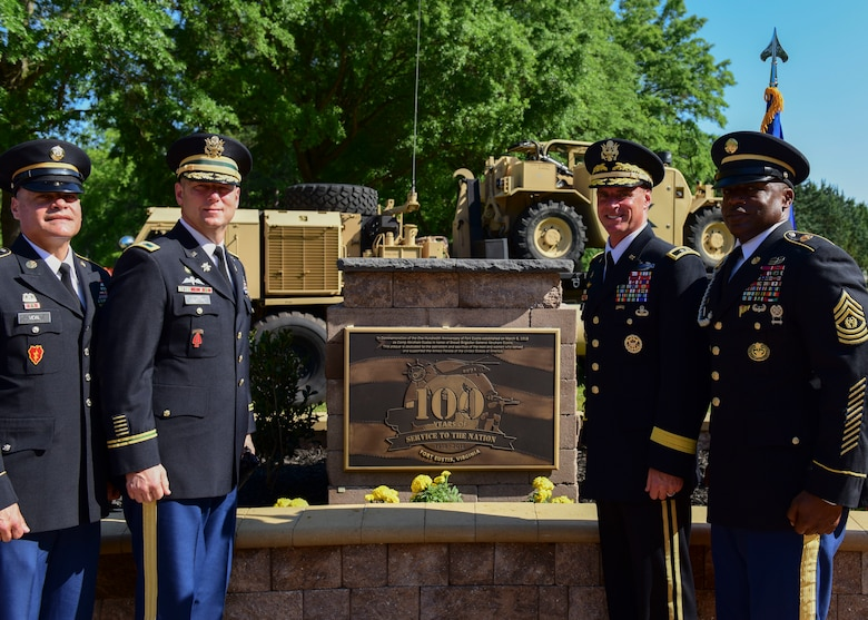 Fort Eustis leaders stand next to a Fort Eustis 100th Anniversary plaque at Joint Base Langley-Eustis, Virginia, May 11, 2018. In conjunction with Fort Eustis' 100th anniversary celebration, Joint Base Langley-Eustis rededicated Seay Plaza to pay tribute to the 50th anniversary of the Vietnam War during a time capsule burial ceremony. (U.S. Air Force photo by Airman 1st Class Monica Roybal)