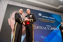 U.S. Marine Corps Gen. Joe Dunford, right, chairman of the Joint Chiefs of Staff, presents the Atlantic Council's Distinguished Military Leadership Award to U.S. Army Gen. Curtis M. Scaparrotti, left, Commander of U.S. European Command and Supreme Allied Commander, Europe; during the council's Distinguished Leaderships Awards dinner in Washington, D.C., May 10, 2018. The awards also recognized former U.S. President George W. Bush, Mr. Howard Schultz, Executive Chairman of Starbucks Corporation; and Ms. Gloria Estefan, Grammy Award-Winning Singer; for embodying the pillars of the transatlantic relationship for their achievement in the fields of politics, military, business, humanitarian, and artistic leadership.