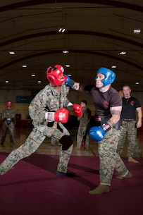Gunnery Sgt. Justin Kratzer, Radio Maintenance Chief, delivers what looks to be a devestating to blow to Cpl. Jacob Brown, administrative clerk, during the controlled sparring phase of their 3-week long Martial Arts Instructors Course (MAIC) aboard Marine Corps Logistics Base Barstow, Calif., May 10.