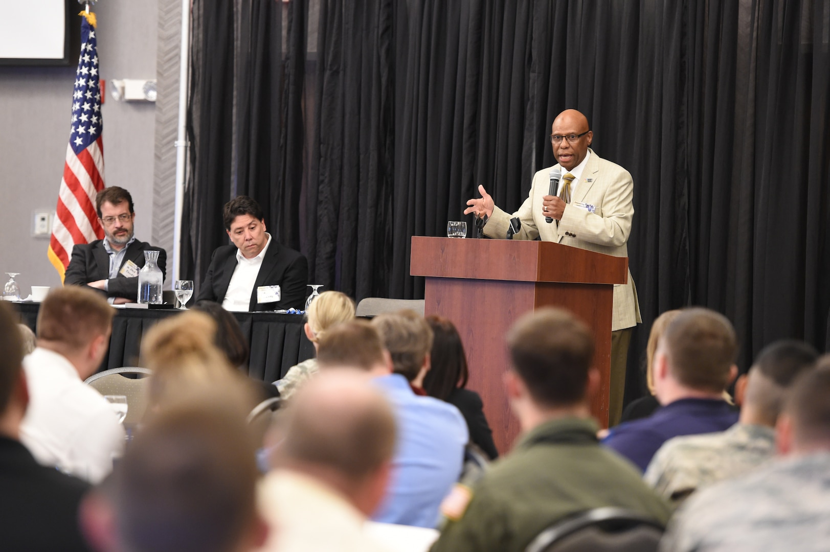 """Craig Jacobs, director of Omaha Henry Doorly Zoo and Aquarium human resources, speaks at the 2nd annual """"Empowering Tomorrow's Leaders"""" conference at the Beardmore Event Center in Bellevue, Neb., May 7, 2018. More than 300 attendees, nominated by their leadership, attended the all-day event. The theme this year was """"Igniting Innovation: How to Go Faster"""" featuring speakers and panelists to inspire out-of-the box thinking. (U.S. Navy photo by Mass Communication Specialist 1st Class Julie R. Matyascik)"""
