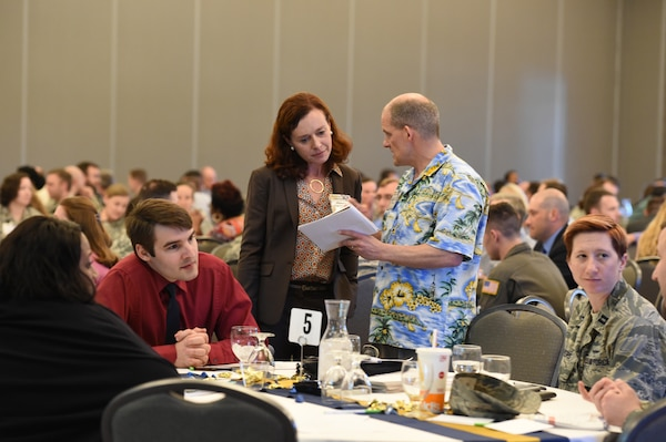 "Whitney Hischier, Red Team Thinking LLC and lecturer, University of California, Berkeley, speaks with Travis Tucker, U.S. Strategic Command cyber analyst, at the 2nd annual ""Empowering Tomorrow's Leaders"" conference at the Beardmore Event Center in Bellevue, Neb., May 7, 2018. More than 300 attendees, nominated by their leadership, attended the all-day event. The theme this year was ""Igniting Innovation: How to Go Faster"" featuring speakers and panelists to inspire out-of-the box thinking. (U.S. Navy photo by Mass Communication Specialist 1st Class Julie R. Matyascik)"