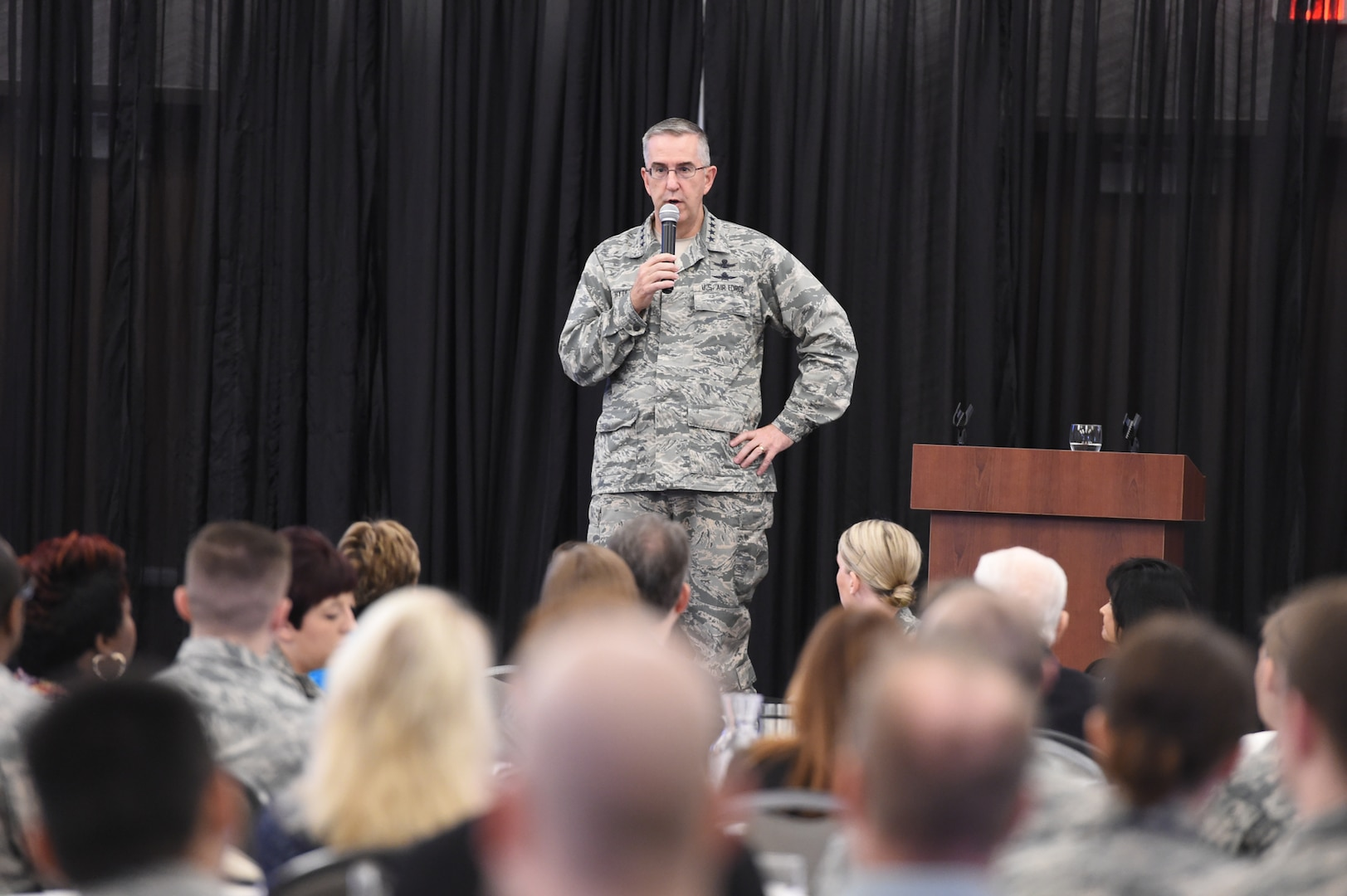 """U.S. Air Force Gen. John Hyten, commander of U.S. Strategic Command (USSTRATCOM) gives welcoming remarks to attendees of the 2nd annual """"Empowering Tomorrow's Leaders"""" conference at the Beardmore Event Center in Bellevue, Neb., May 7, 2018. More than 300 attendees, nominated by their leadership, attended the all-day event. The theme this year was """"Igniting Innovation: How to Go Faster"""" featuring speakers and panelists to inspire out-of-the box thinking. (U.S. Navy photo by Mass Communication Specialist 1st Class Julie R. Matyascik)"""