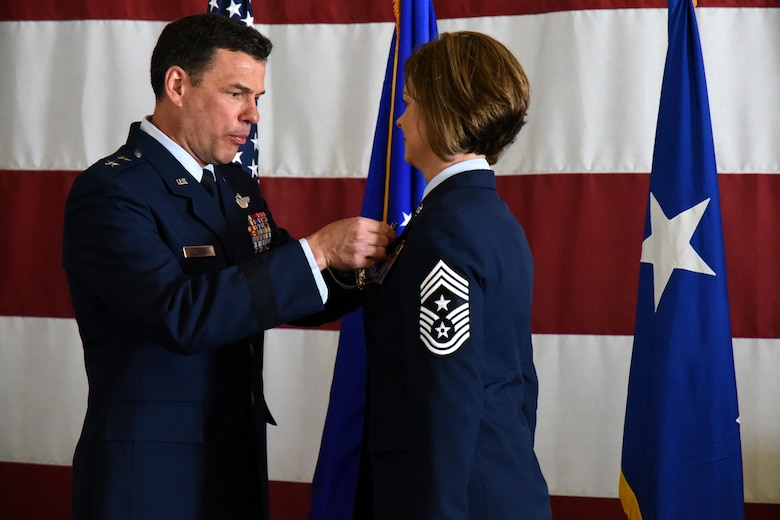U.S. Air Force Maj. Gen. Matthew Molloy, Air Force Operational Test and Evaluation Center commander, pins the Legion of Merit Medal onto Chief Master Sgt. Bobbie Fillbrandt during her retirement ceremony at the Louis F. Garland Department of Defense Fire Academy on Goodfellow Air Force Base, Texas, May 10, 2018. The Legion of Merit is an award given for exceptionally meritorious conduct in the performance of outstanding services and achievements. (U.S. Air Force photo by Airman 1st Class Seraiah Hines/Released)