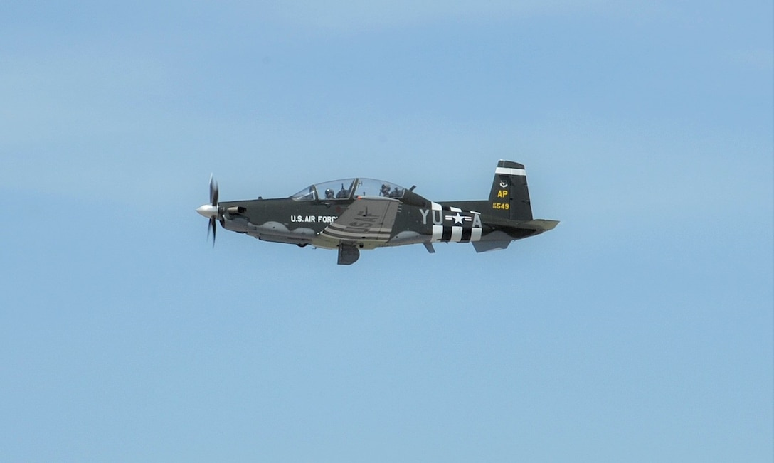 Capt. Kais Heimburger, 455th FTS instructor pilot and Lt. Col. Nik Stathopoulos, 455th FTS director of operations fly a T-6 Texan ll aircraft with  WWII-era B-26 Marauder paint scheme, May 8, 2018 at Joint Base San Antonio-Randolph.  The aircraft is assigned to the 455th Flying Training Squadron at NAS Pensacola, Florida.  (U.S. Air Force photo by Joel Martinez)
