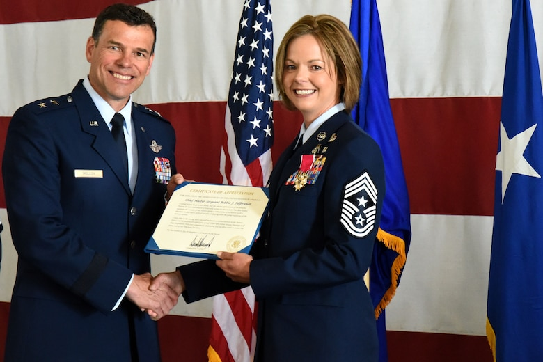 U.S. Air Force Maj. Gen. Matthew Molloy, Air Force Operational Test and Evaluation Center commander, presents Chief Master Sgt. Bobbie Fillbrandt with a certificate of appreciation during her retirement ceremony at the Louis F. Garland Department of Defense Fire Academy on Goodfellow Air Force Base, Texas, May 10, 2018. The certificate presented was on behalf of President Donald Trump, expressing congratulations and thanks for all her service leading up to retirement. (U.S. Air Force photo by Airman 1st Class Seraiah Hines/Released)